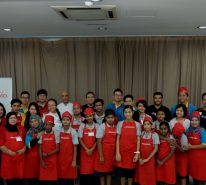 "A group photo with the children from ""Dignity For Children Foundation"" together with the volunteers and Ajinomoto® staff"