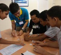 The participants work together to solve the given puzzle for the 2nd game.